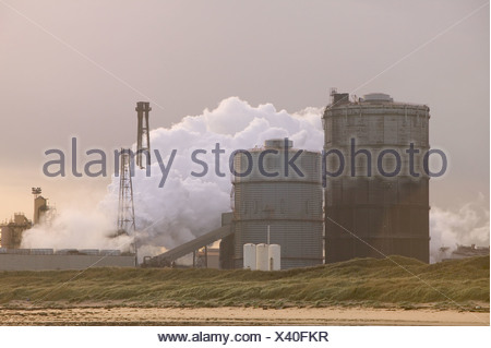 The corus steelworks at Redcar, Teeside, releasing clouds of steam and pollution - Stock Photo