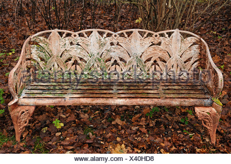 Fine cast iron garden bench covered in autumn leaves, Villa & Ambiente, Nuremberg, Middle Franconia, Bavaria, Germany, Europe - Stock Photo