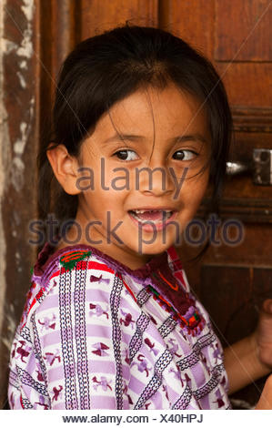 Girl, portrait, School of Santiago Atitlan, Lago de Atitlan, Guatemala, Central America - Stock Photo