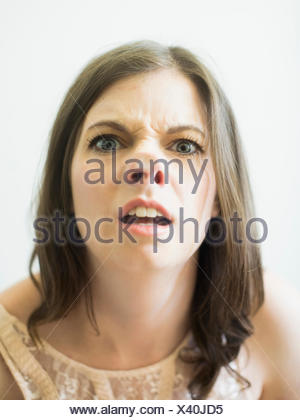 Woman making funny face on glass - Stock Photo