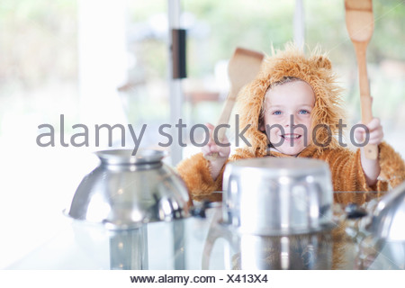 Boy pretending to be drummer - Stock Photo