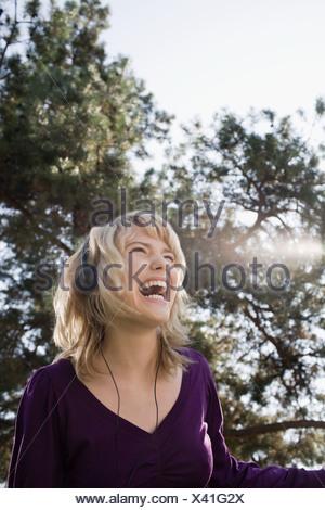 Teenage girl listening to music - Stock Photo