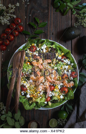 A big bowl of grilled shrimp and corn salad photographed from the top view. - Stock Photo