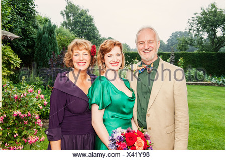 Portrait of newly married daughter with her parents - Stock Photo