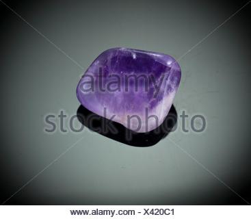 Cutout of an amethyst gemstone on black background - Stock Photo