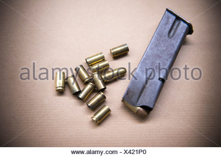 Close up of bullet casings and clip - Stock Photo