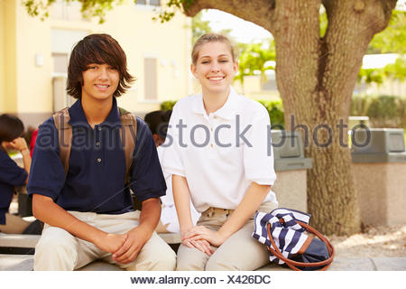 High School Students Wearing Uniforms On School Campus - Stock Photo
