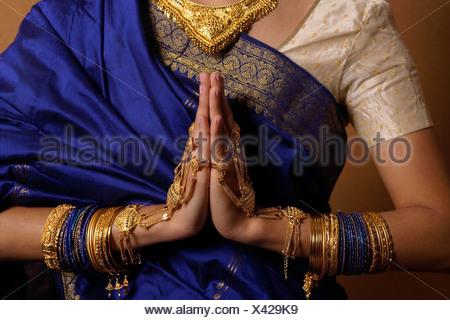 Torso of Indian woman wearing sari and jewelry - Stock Photo