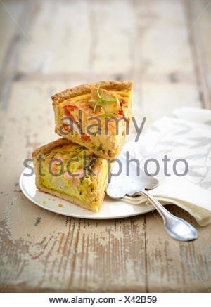 Slice of chicken and pepper savory tart and  salmon and cauliflower savory tart - Stock Photo