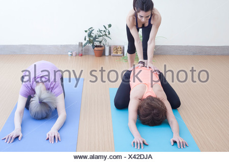 Women in child's pose - Stock Photo