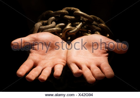 Chained hands - Stock Photo