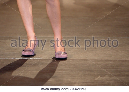 Legs of a female model on the catwalk, Berlin, Germany - Stock Photo