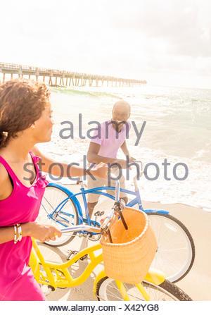 USA, Florida, Jupiter, Young couple during bike trip - Stock Photo