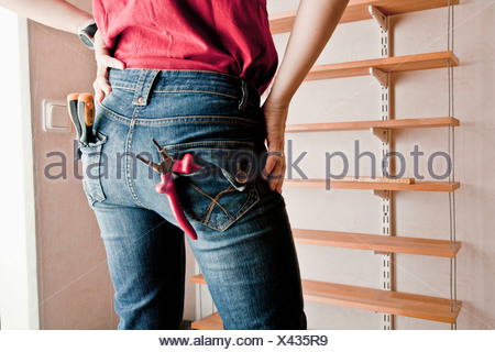 Woman with tools in pocket - Stock Photo