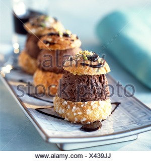 Home-made profiteroles with plain chocolate ice cream - Stock Photo