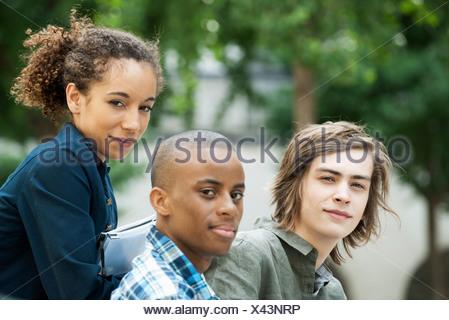 Friends hanging out, portrait - Stock Photo