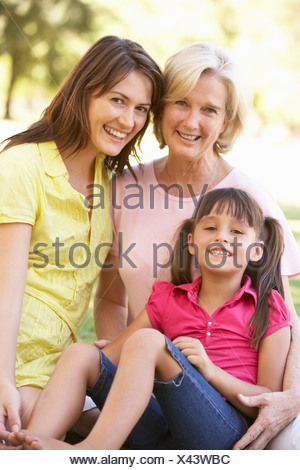 Grandmother With Mother And Daughter In Park - Stock Photo