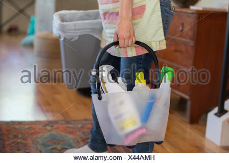 Young woman cleaning home with green cleaning products - Stock Photo