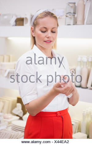 Pretty blonde trying a perfume - Stock Photo
