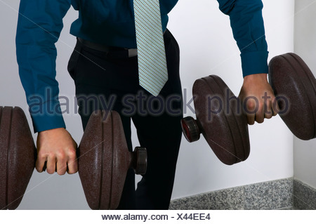 Office worker weightlifting - Stock Photo