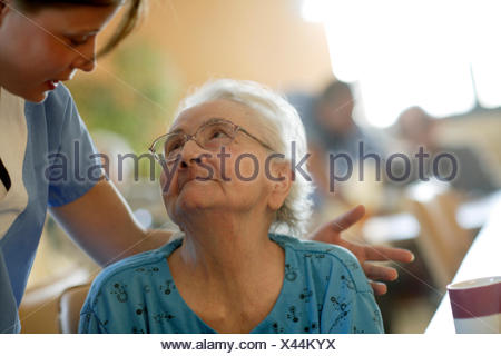 Nursing home, elderly woman with a nurse - Stock Photo