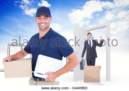 Composite image of happy delivery man with cardboard box and clipboard - Stock Photo