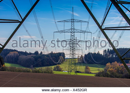 power pole in the pre-Alps 230 KV tension lines, Germany, Bavaria - Stock Photo