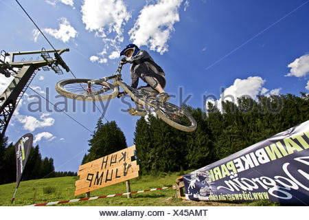 man jumping with a mountain bike, Austria - Stock Photo