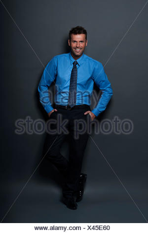 Relaxed and confident businessman looking at camera Debica, Poland - Stock Photo