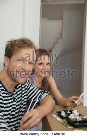 Portrait couple lunch resting eating sushi - Stock Photo