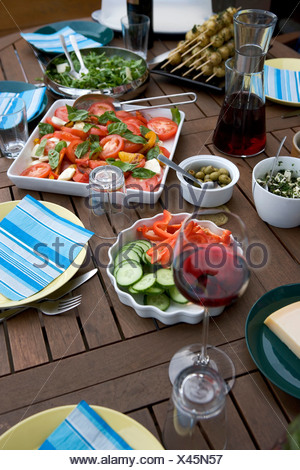 Close-up of food and beverage set on the wooden dining table - Stock Photo