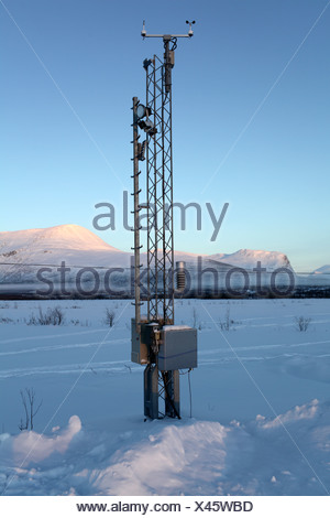 Weather station in snowy landscape - Stock Photo