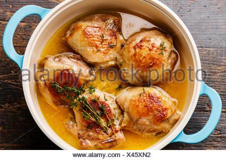 Roast chicken stew in cast iron pan close-up - Stock Photo