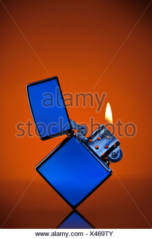 Blue Zippo Lighter With Flame On Orange Background