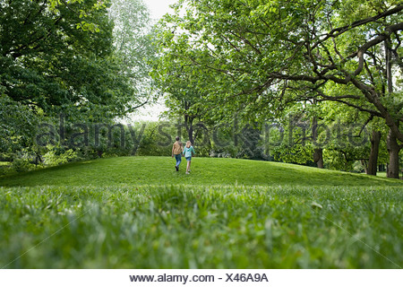 Teenage couple walking in a park - Stock Photo