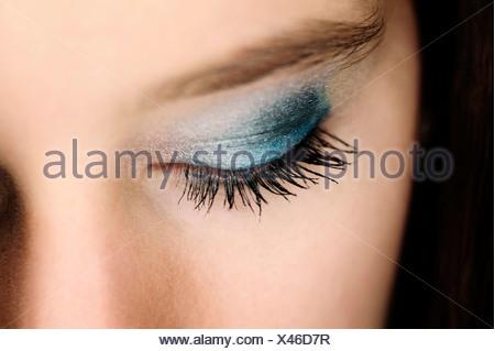 Woman's eye lid, woman wearing eye shadow - Stock Photo