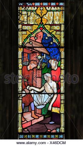 Parable of The Good Samaritan, stained glass by Frederick Preedy, 1865, Gunthorpe, Norfolk, England, UK, Good Samaritan carresi injured traveller - Stock Photo