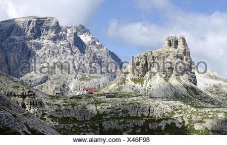 Three peaks shelter with Sextner Stone - Stock Photo