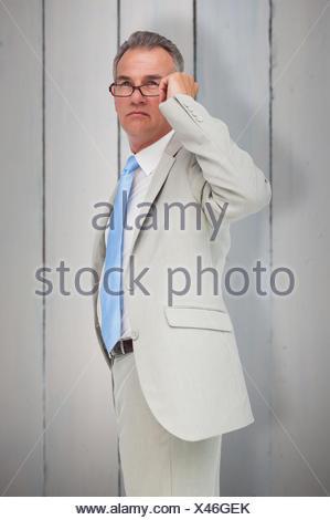 Composite image of thinking businessman - Stock Photo