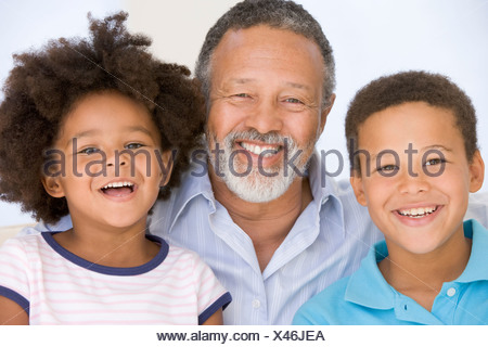 Man and two young children smiling - Stock Photo