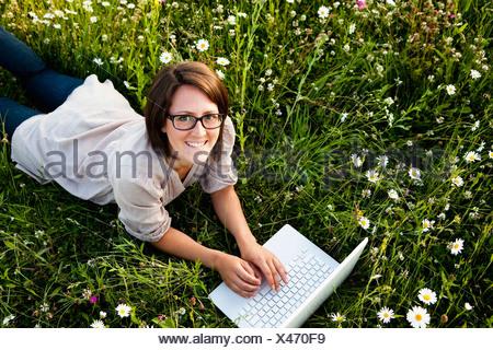 Woman typing on laptop - Stock Photo
