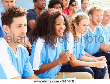 Spectators In Team Colors Watching Sports Event - Stock Photo