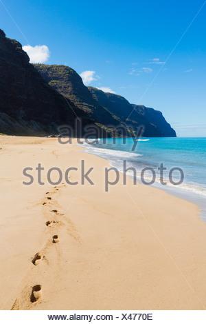 Hawaii, Kauai, Polihale Beach, Footprints in sand. - Stock Photo