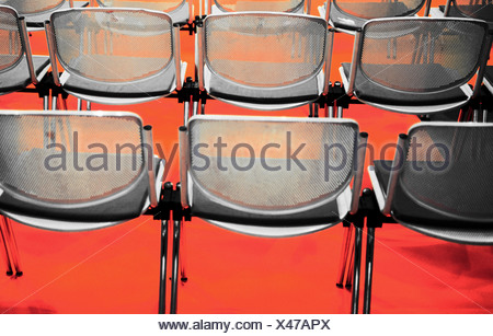 Rear view of empty chairs in rows - Stock Photo