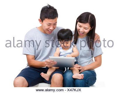 Parent using tablet with thier baby son - Stock Photo