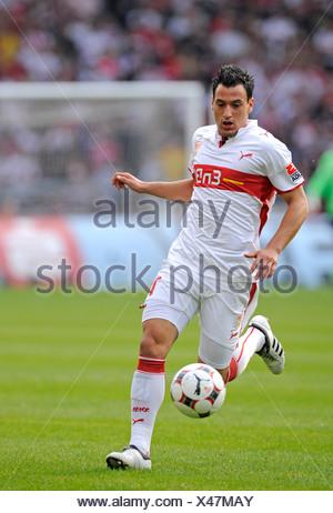 Timo Gebhart, German footballer playing for VfB Stuttgart, leading the ball - Stock Photo