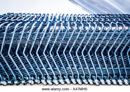 Shopping Carts Arranged In Row At Supermarket - Stock Photo