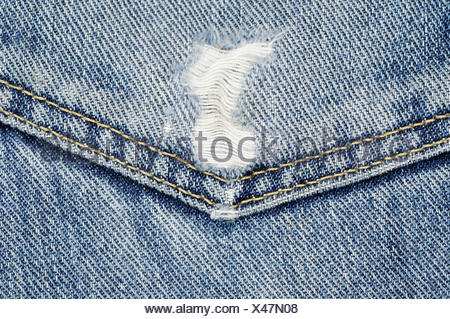 Worn out jeans pocket - Stock Photo