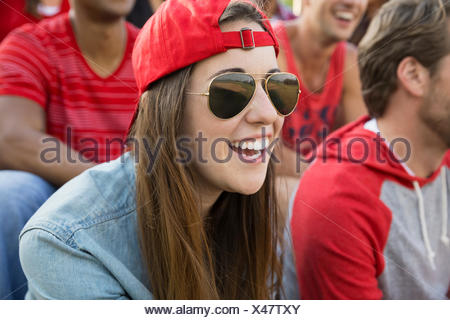 Woman laughing at sporting event - Stock Photo