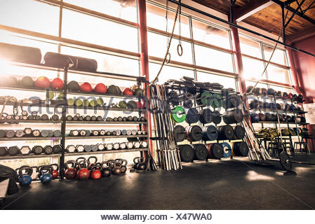 Gym equipment - weights, gym balls, kettle bells - Stock Photo